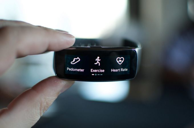 Fitness tracker held in hand