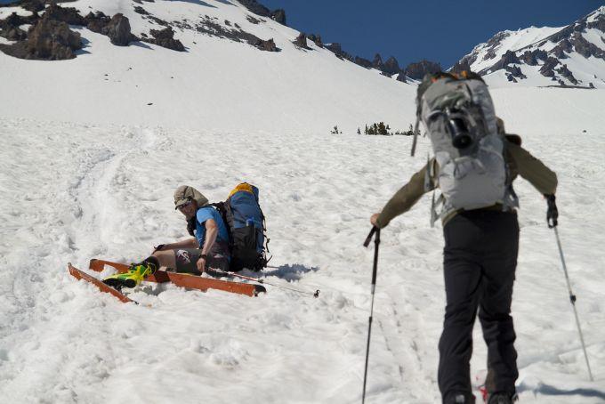 Skiers wearing ski bacpacks