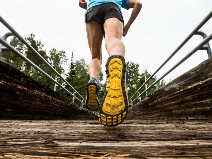 Image showing a man running in trail shoes on a bridge
