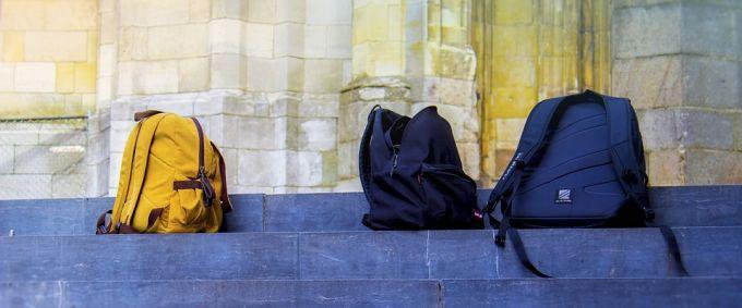 travel backpacks on steps