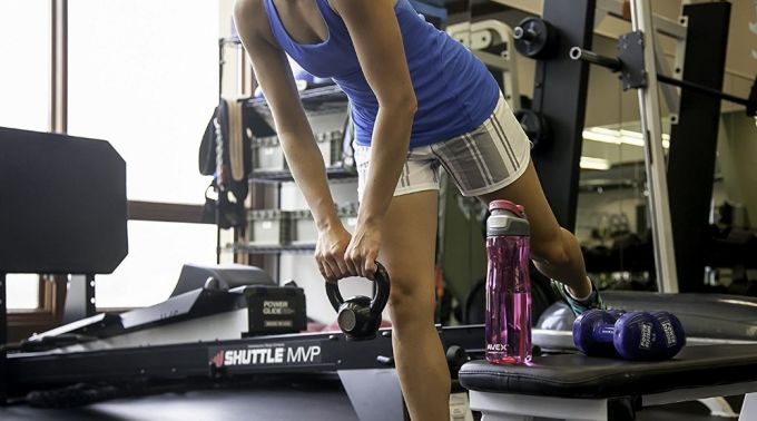 workout in gym with water bottle