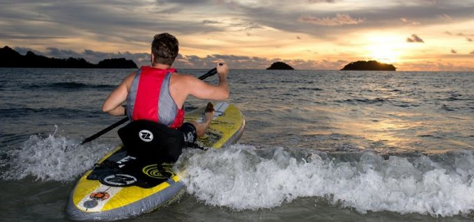 paddle boarding with safe vest