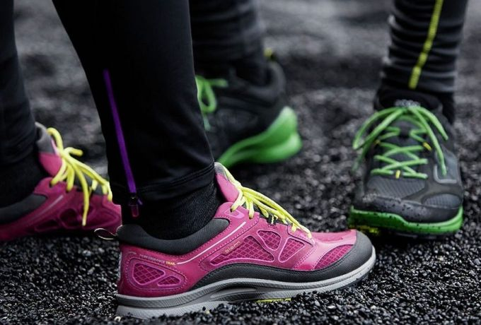 A couple of persons wearing trail-running-shoes-for-women