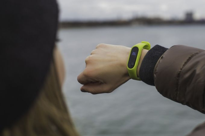 A woman checking her fitness tracker