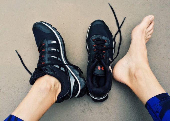 Running shoe on one leg
