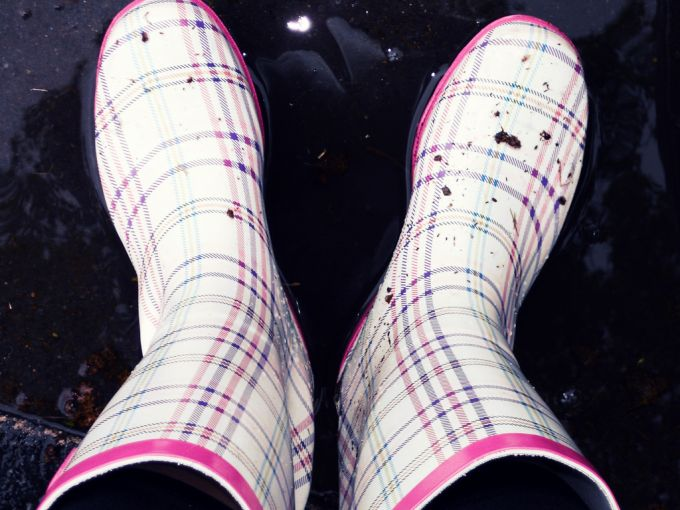 White rain boots in the rain