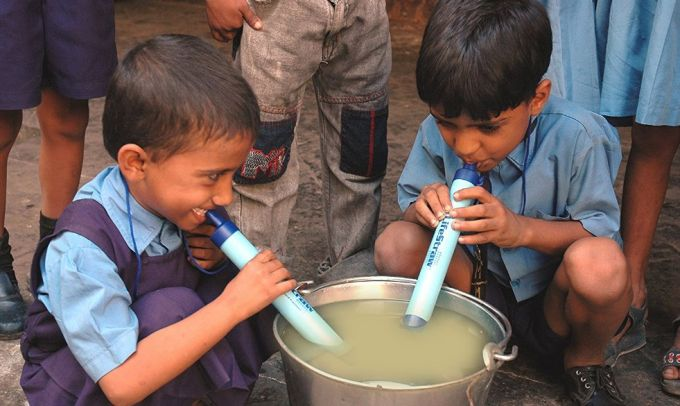 two kids with lifestraw personal water filter