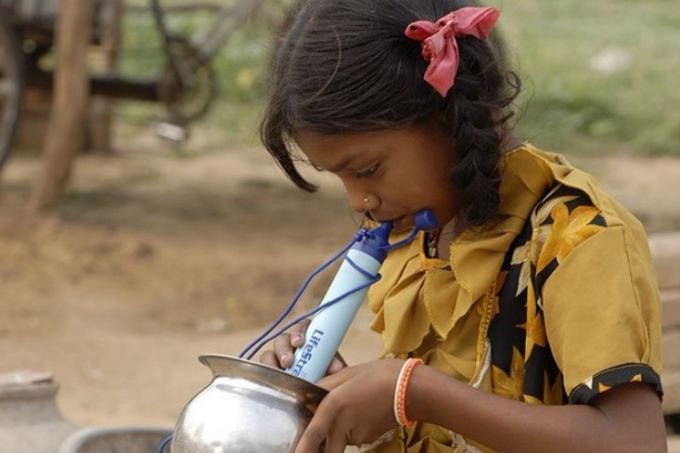 girl with lifestraw personal water filter