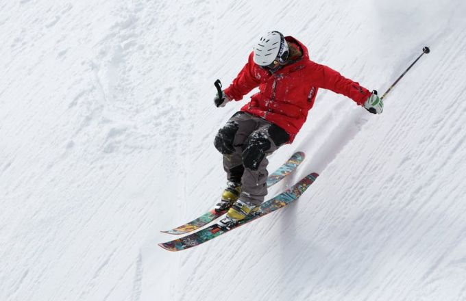 A man skiing down a hill
