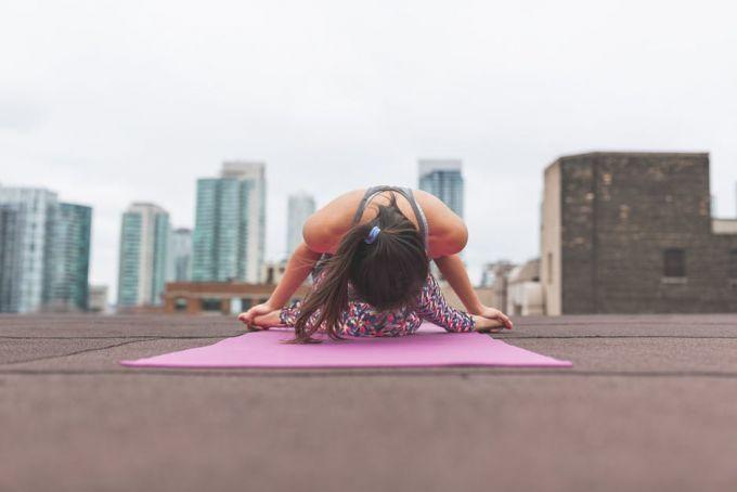 A woman doing yoga on a mat