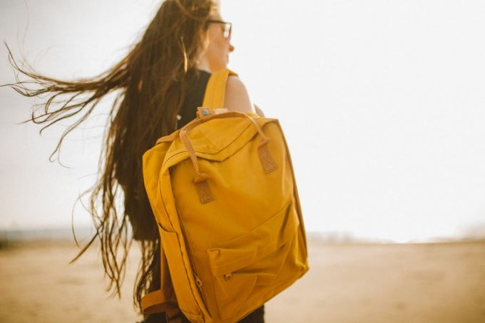 A yellow laptop backpack and a girl