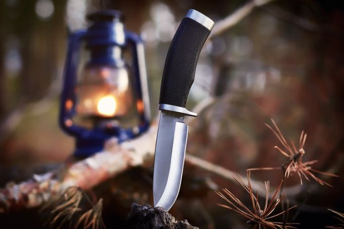 A survival knife outdoors