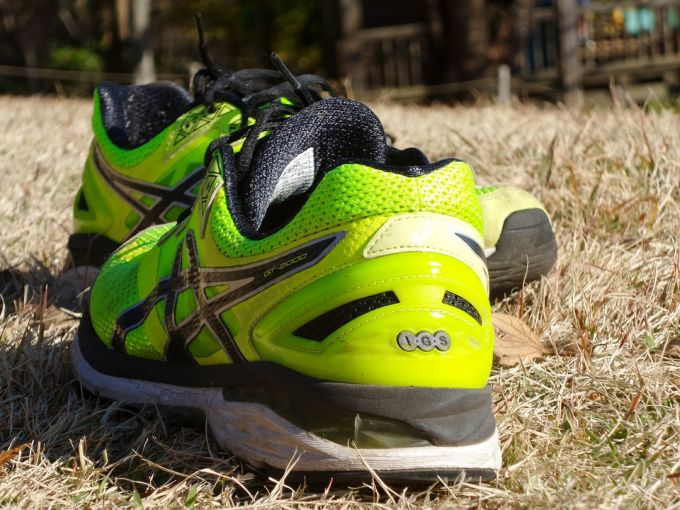 Green crossfit shoes on the grass