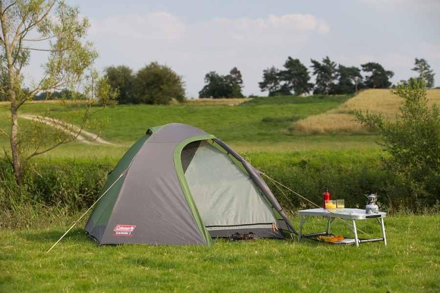 Backpacking tent on the field