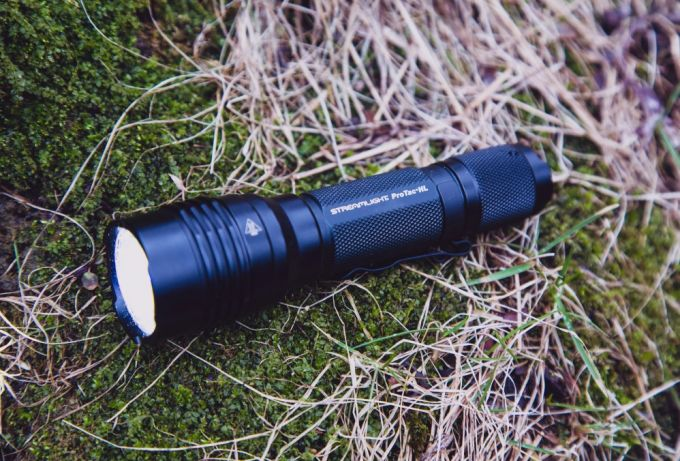 Flashlight on Ground