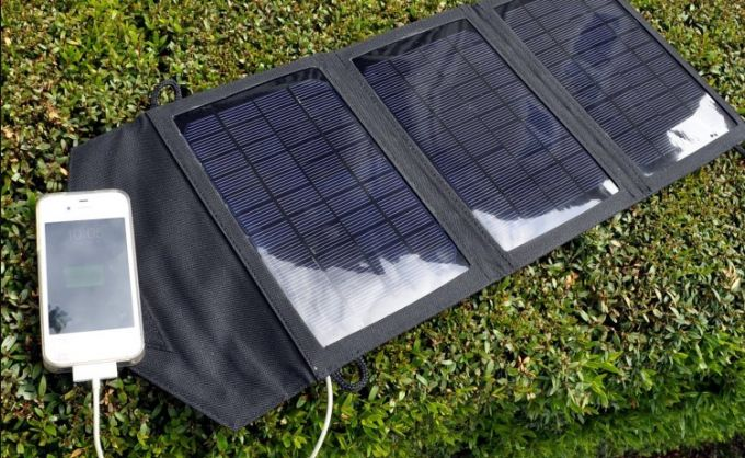 iPhone charging on portable solar panels