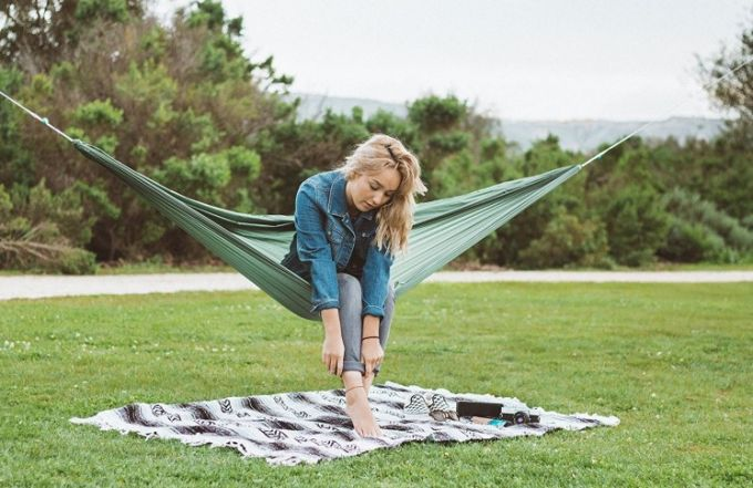 girl on a green camping hammock