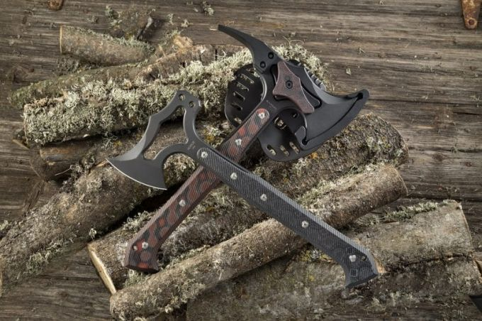 Image showing two tactical tomahawk on some woods