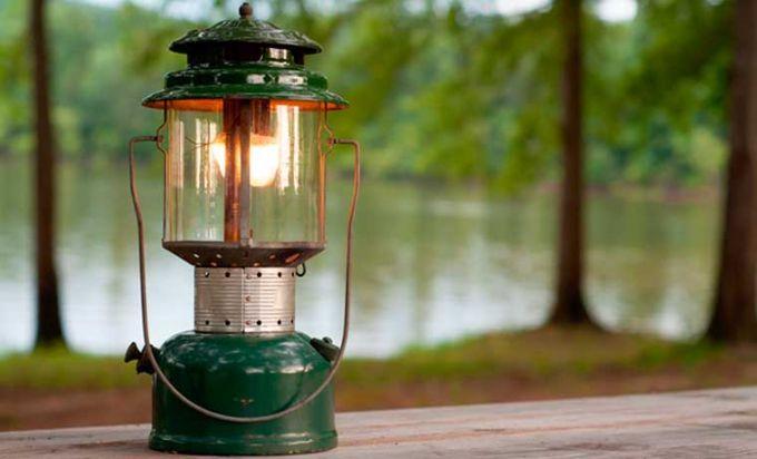 Image showing a camping lantern next to a lake