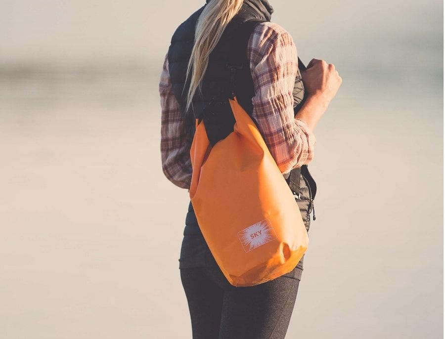 Woman with waterproof bag