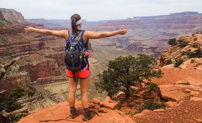 A woman hiker hiking in the grand canyon while she is wearing a pair of hiking boots