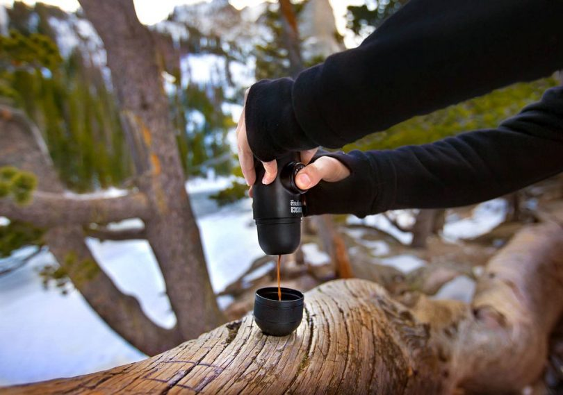 Image of a man doing coffee with a Portable Espresso Maker