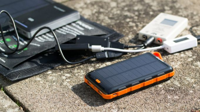 Image showing a solar phone charger and a battery used with it
