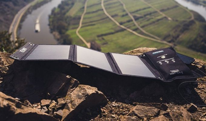 Solar powered phone charger and a river view