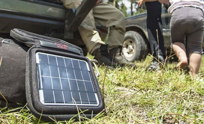 Image showing a solar phone charger and a familly in the background