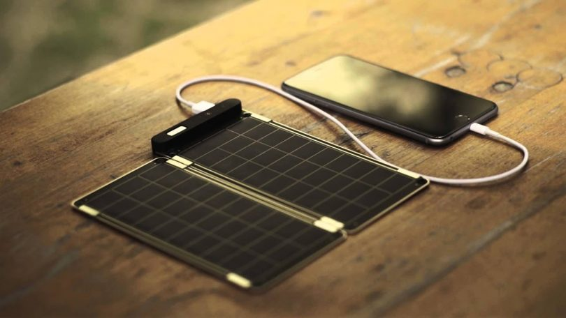 Image showing a solar power charging a phone