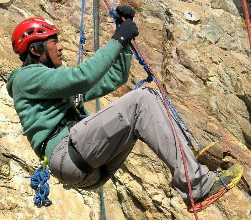 Man climbing with climbing harness