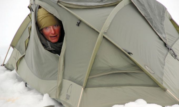 man in solo tent in winter