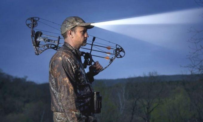 hunter with headlamp