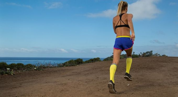 girl running with compression socks