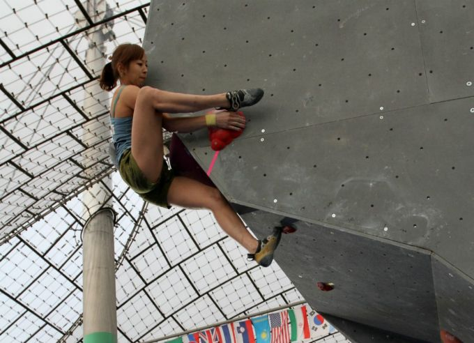 Woman climbing on a wall