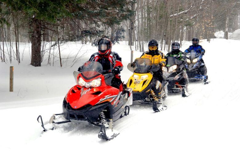Snowy snowmobile convoy