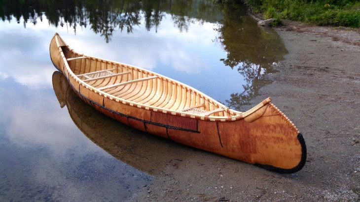 Beautiful canoe on lakeshore