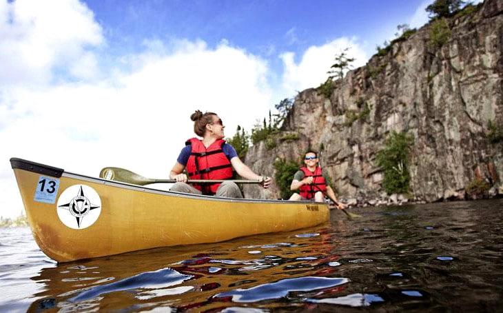 Couple rowing canoe