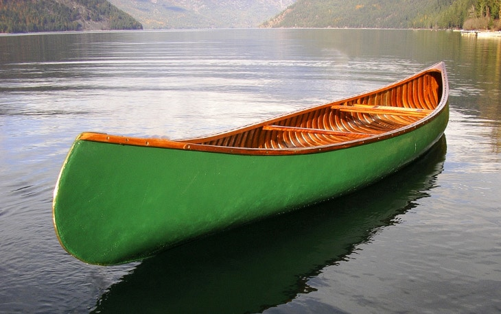 Green wilderness canoe