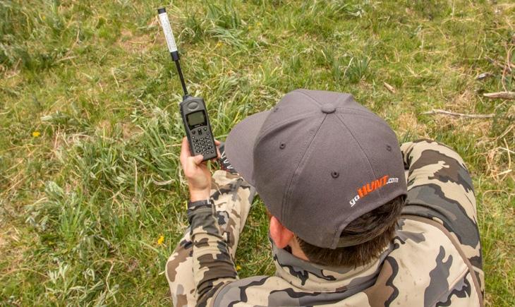 Hunter using satellite phone