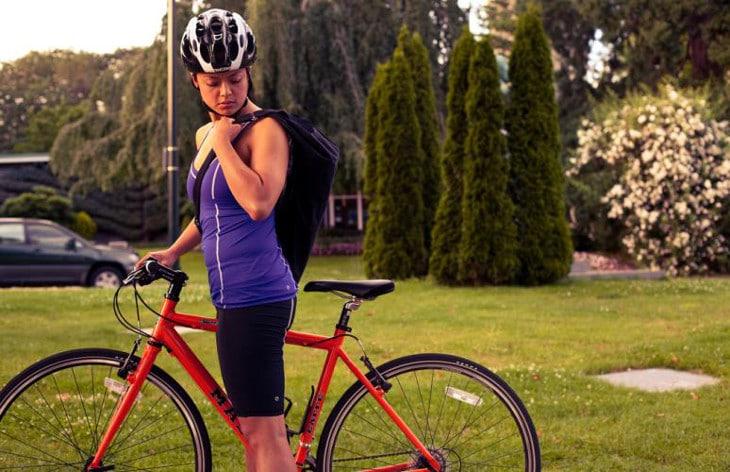 Lady with hybrid bike