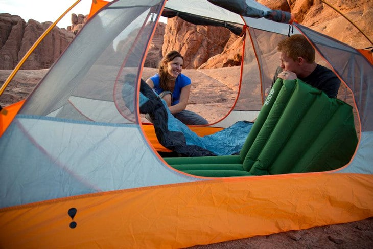 Setting tent and sleeping bags