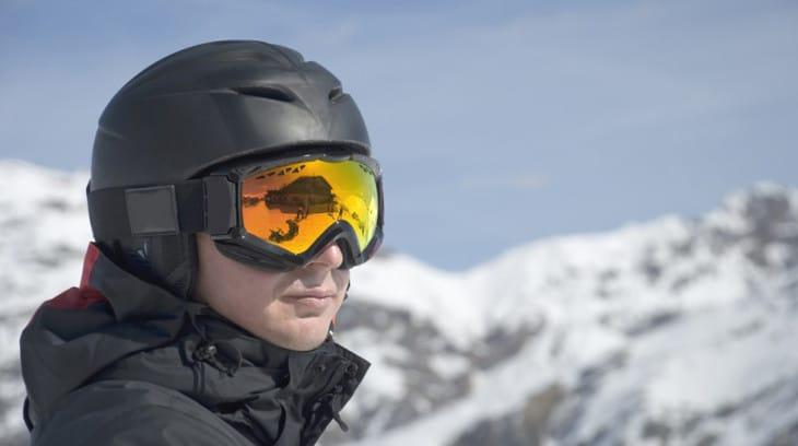 Skier wearing matte ski helmet