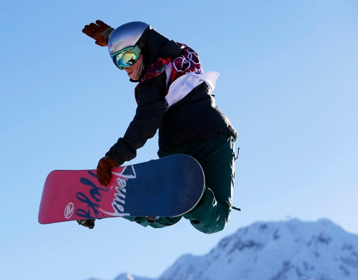 Snowboarding girl jumps