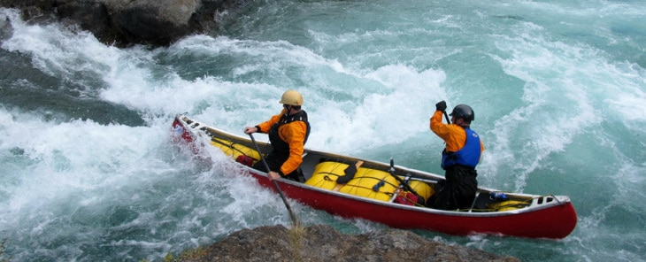 Whitewater canoe in action