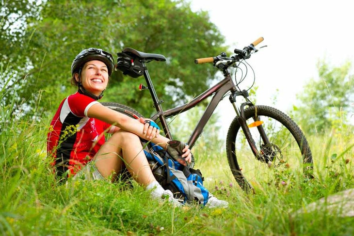 Woman rests after biking