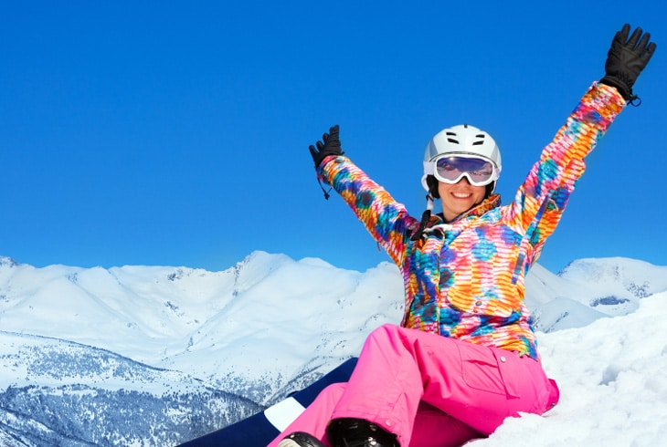 Woman snowboarder enjoying the snow