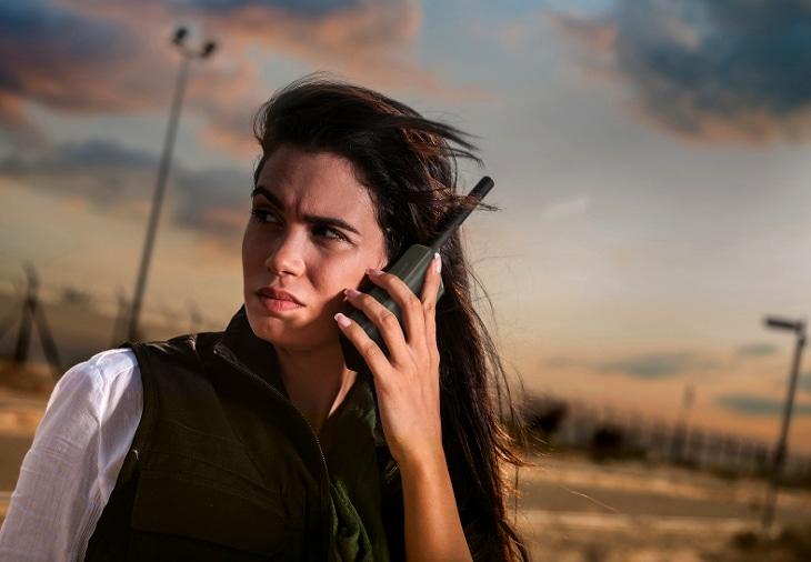 Woman using sat phone