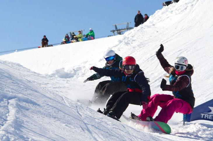 Women trio snowboard action