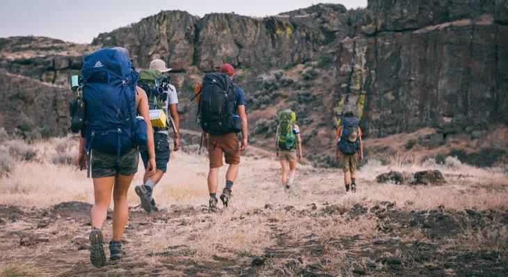 Backpackers hiking on trail